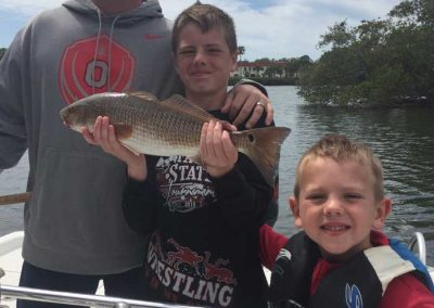 Salty-Water-Fishing-Charters-Dunedin-Clearwater-Florida-Tarpon-Springs-Customers-Happy-Family-Friendly-Catching-Tarpon-Snook-1