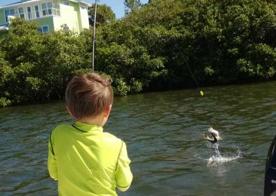 Salty-Water-Fishing-Charters-Dunedin-Clearwater-Florida-Tarpon-Springs-Customers-Happy-Family-Friendly-Catching-Tarpon-Snook-12322