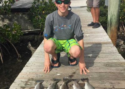 Salty-Water-Fishing-Charters-Dunedin-Clearwater-Florida-Tarpon-Springs-Customers-Happy-Family-Friendly-Catching-Tarpon-Snook-166