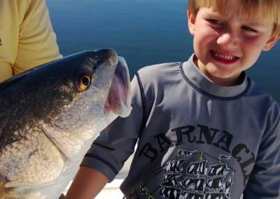 Salty-Water-Fishing-Charters-Dunedin-Clearwater-Florida-Tarpon-Springs-Customers-Happy-Family-Friendly-Catching-Tarpon-Snook-1998